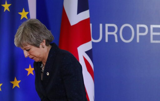 (AP Photo/Frank Augstein). British Prime Minister Theresa May leaves after addressing a media conference at an EU summit in Brussels, Friday, March 22, 2019. Worn down by three years of indecision in London, EU leaders on Thursday were grudgingly leani...