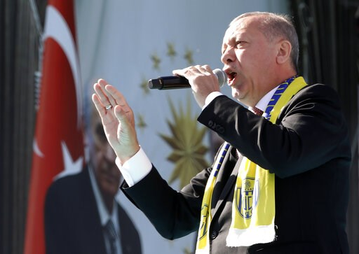 (AP Photo/Burhan Ozbilici). Turkey's President Recep Tayyip Erdogan sings a political song before his address to the supporters of his ruling Justice and Development Party, AKP, during a rally in Ankara, Turkey, Saturday, March 23, 2019, ahead of local...