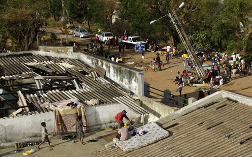 (AP Photo/Themba Hadebe). Displaced families set up their bedding on top of the roof in Buzi district, 200 kilometers (120 miles) outside Beira, Mozambique, on Saturday, March 23, 2019. A second week has begun with efforts to find and help some tens of...