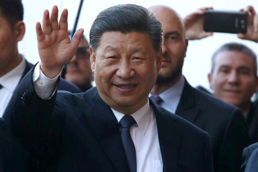 (Igor Petyx/ANSA via AP). Chinese President Xi Jinping salutes upon arrival at the Royal Palace in Palermo, Sicily island, Italy, Saturday, March 23, 2019.