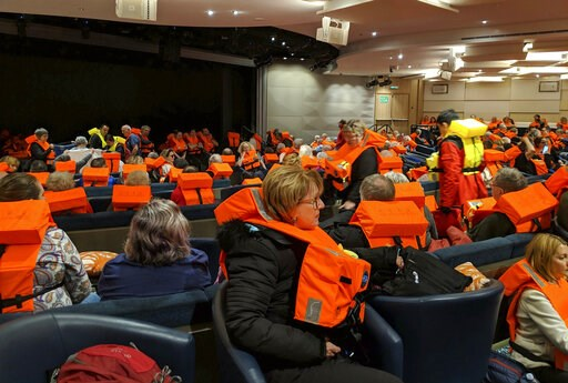 (Michal Stewart via AP). This photo provided by Michal Stewart shows passengers on board the Viking Sky, waiting to be evacuated, off the coast of Norway on Saturday, March 23, 2019. Rescue workers off Norway's western coast rushed to evacuate 1,300 pa...