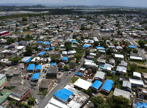 (AP Photo/Dennis M. Rivera, File). This June 18, 2018, file photo shows an aerial view of the Amelia neighborhood in the municipality of Catano, east of San Juan, Puerto Rico. A long-delayed disaster aid bill that's a top political priority for some of...