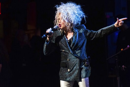 """(Photo by Charles Sykes/Invision/AP, File). FILE - In this Dec. 8, 2018 file photo, Cyndi Lauper performs at the 8th annual """"Home for the Holidays"""" benefit concert at the Beacon Theatre in New York. A university in Vermont has announced Lauper will ret..."""