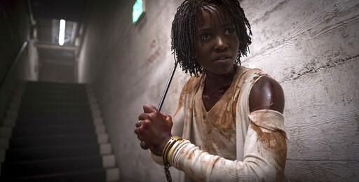 """(Claudette Barius/Universal Pictures via AP). This image released by Universal Pictures shows Lupita Nyong'o in a scene from """"Us,"""" written, produced and directed by Jordan Peele."""