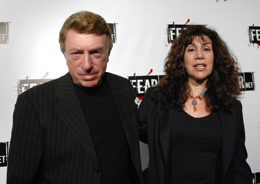 (AP Photo/Phil McCarten, File). File-This Oct. 30, 2006, file photo shows writer, director Larry Cohen, left, and wife Cynthia Cohen arriving for the Comcast, Sony and Lionsgate launch party for FEARnet, a multi-platform network dedicated to horror, he...