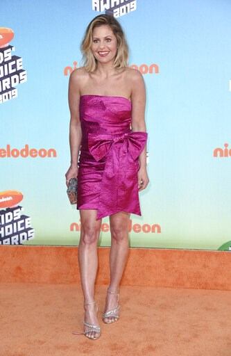 """(Photo by Richard Shotwell/Invision/AP). This photo taken Saturday, March 23, 2019, shows Candace Cameron-Bure arriving at the Nickelodeon Kids' Choice Awards in Los Angeles. Bure says """"family sticks together no matter what,"""" in what seems a sign of su..."""