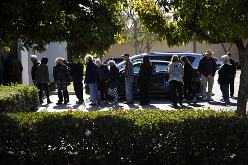 (AP Photo/Jae C. Hong). In this Feb. 19, 2019 photo, a group of retired seniors from Laguna Woods Village form a line outside Bud and Bloom cannabis dispensary to attend a presentation organized by cannabis product vendors in Santa Ana, Calif. More Ame...