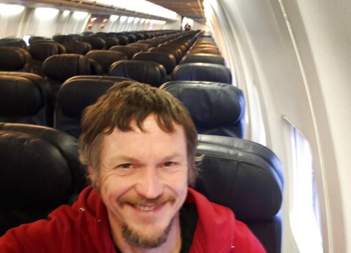 (Skirmantas Strimaitis via AP). Skirmantas Strimaitis takes a selfie onboard a Boeing 737-800 airplane, taking off from Vilnius, Lithuania, March 16, 2019, as the only passenger aboard. The aircraft with two pilots and five crew members and which usual...