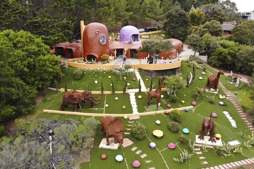 (AP Photo/Terry Chea). This Monday, April 1, 2019 photo, shows an aerial view of the Flintstone House in Hillsborough, Calif. The San Francisco Bay Area suburb of Hillsborough is suing the owner of the house, saying that she installed dangerous steps, ...