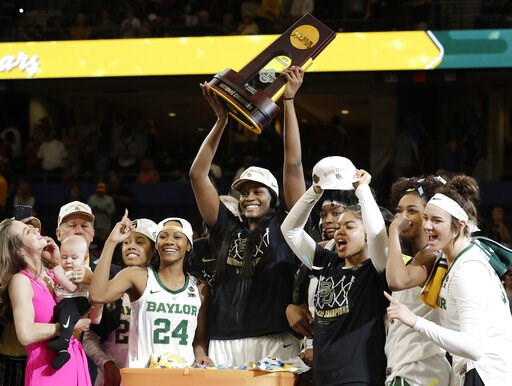(AP Photo/Chris O'Meara). Baylor center Kalani Brown holds the championship trophy next to guard Chloe Jackson (24) after Baylor defeated Notre Dame 82-81 in the final of the NCAA women's college basketball tournament Sunday, April 7, 2019, in Tampa, F...