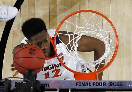 (AP Photo/Jeff Roberson). Virginia's De'Andre Hunter (12) goes up for a basket during the first half in the championship of the Final Four NCAA college basketball tournament against Texas Tech, Monday, April 8, 2019, in Minneapolis.