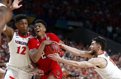 (AP Photo/Jeff Roberson). Texas Tech's Jarrett Culver (23) drives against Virginia's Ty Jerome (11) and De'Andre Hunter (12) during the overtime in the championship of the Final Four NCAA college basketball tournament, Monday, April 8, 2019, in Minneap...