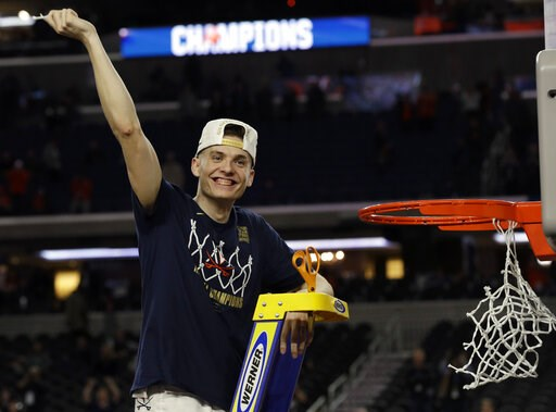 (AP Photo/David J. Phillip). Virginia's Kyle Guy celebrate after defeating Texas Tech 85-77 in the overtime in the championship of the Final Four NCAA college basketball tournament, Monday, April 8, 2019, in Minneapolis.