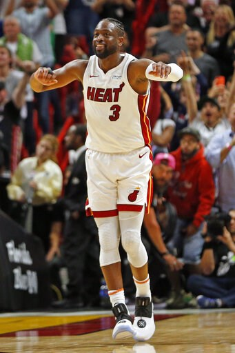 (AP Photo/Joel Auerbach). Miami Heat guard Dwyane Wade (3) runs up the court to celebrate the win against the Dallas Mavericks at an NBA basketball game, Thursday, March 28, 2019, in Miami. The Heat beat the Mavericks 105-99.