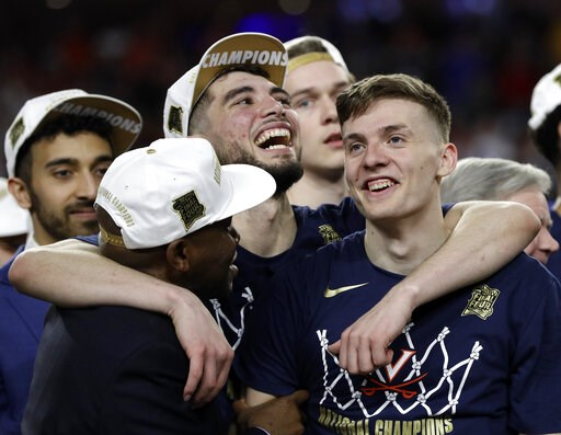 (AP Photo/David J. Phillip). Virginia's Ty Jerome, center, and Kyle Guy, right, celebrate after defeating Texas Tech 85-77 in the overtime in the championship of the Final Four NCAA college basketball tournament, Monday, April 8, 2019, in Minneapolis.