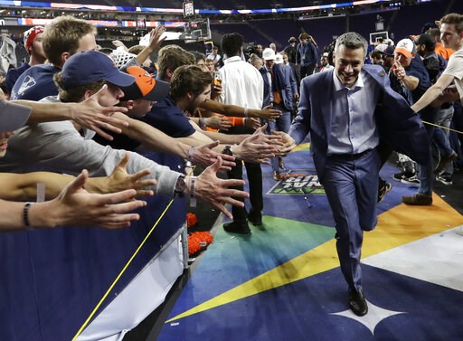 (AP Photo/David J. Phillip). Virginia head coach Tony Bennett celebrates with fans after the championship game against Texas Tech in the Final Four NCAA college basketball tournament, Monday, April 8, 2019, in Minneapolis. Virginia won 85-77 in overtime.