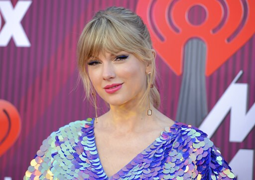 (Photo by Jordan Strauss/Invision/AP, File). FILE - In this March 14, 2019, file photo, Taylor Swift arrives at the iHeartRadio Music Awards at the Microsoft Theater in Los Angeles. Swift says the efforts of a Tennessee LGBTQ advocacy group to fight ag...