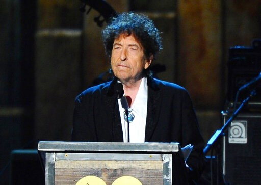(Photo by Vince Bucci/Invision/AP, File). FILE - In this Feb. 6, 2015 file photo, Bob Dylan accepts the 2015 MusiCares Person of the Year award at the 2015 MusiCares Person of the Year show in Los Angeles.  Dylan is set to help open a whiskey distiller...