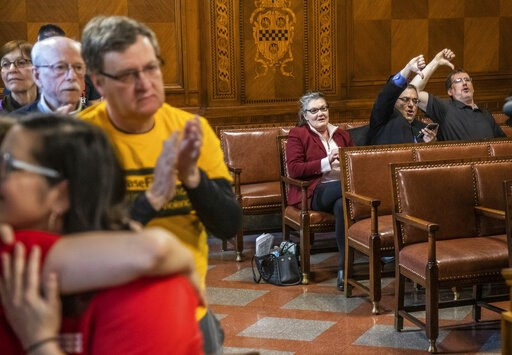 (Andrew Rush/Pittsburgh Post-Gazette via AP). Opponents give a thumbs down, as others applaud, after the Pittsburgh City Council voted 6-3 to pass gun-control legislation, Tuesday, April 2, 2019, in Pittsburgh. The bill, introduced in the wake of the s...