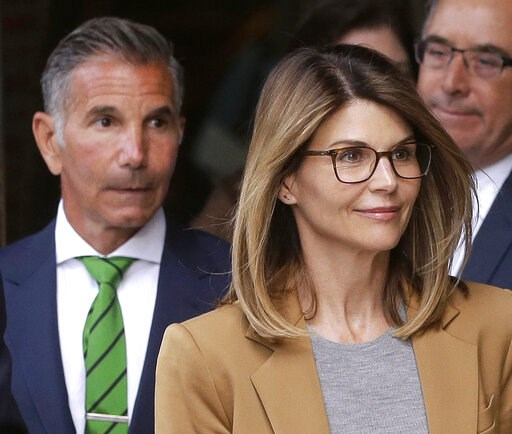 (AP Photo/Steven Senne). Actress Lori Loughlin, front, and husband, clothing designer Mossimo Giannulli, left, depart federal court in Boston on Wednesday, April 3, 2019, after facing charges in a nationwide college admissions bribery scandal.