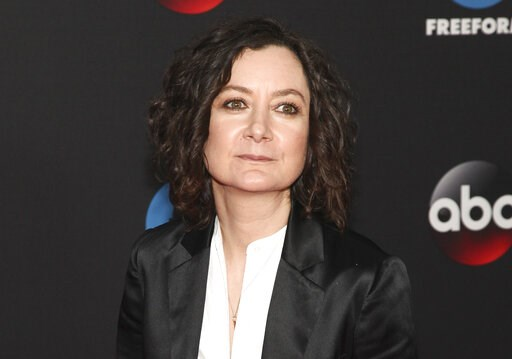 "(Photo by Andy Kropa/Invision/AP, File). FILE - This May 15, 2018 file photo shows Sara Gilbert at the Disney/ABC/Freeform 2018 Upfront Party in New York. Gilbert, a co-host on the CBS show ""The Talk,"" announced Tuesday, April 9, 2019 that she will be ..."