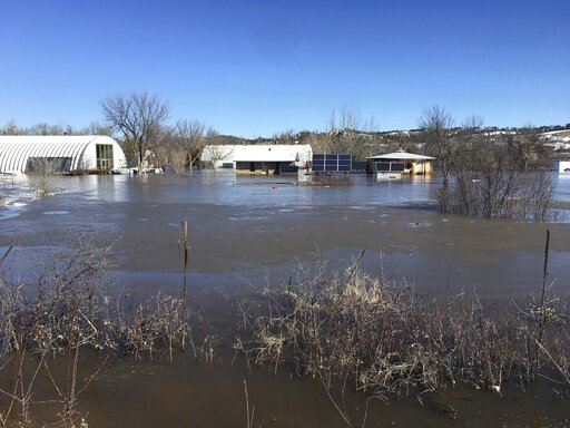 (Henry Red Cloud via AP). In this undated March 2019 photo provided by Henry Red Cloud, shows flooding on Cloud's Lakota Solar Enterprises property on the Pine Ridge Reservation in southern South Dakota. Red Cloud estimates flood damage at $250,000. Pl...