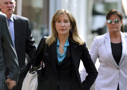 (AP Photo/Charles Krupa, File). FILE - This April 3, 2019 file photo shows actress Felicity Huffman arriving at federal court in Boston to face charges in a nationwide college admissions bribery scandal. Huffman is facing a prison sentence after agreei...