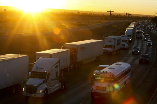 (AP Photo/Christian Torres). A row of trucks wait to cross the border with the United States in Ciudad Juarez, Mexico, Tuesday, April 9, 2019. The Trump administration has reassigned so many inspectors from U.S.-Mexico border crossings that it has caus...