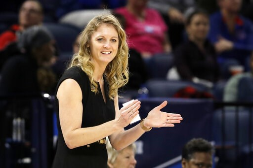(AP Photo/Nam Y. Huh). Missouri State head coach Kellie Harper smiles as he directs her team during the second half of a regional semifinal game against the Stanford in the NCAA women's college basketball tournament, Saturday, March 30, 2019, in Chicago.