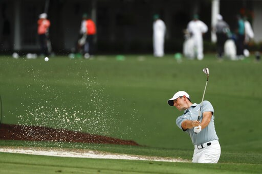 (AP Photo/Matt Slocum). Rory McIlroy, of Northern Ireland, practices on the driving range at the Masters golf tournament Tuesday, April 9, 2019, in Augusta, Ga.