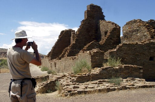 (AP Photo/Jeff Geissler, File). FILE - In this Aug. 10, 2005, file photo, tourist Chris Farthing from Suffolks County, England, takes a picture while visiting Chaco Culture National Historical Park in northwestern New Mexico. Members of New Mexico's co...