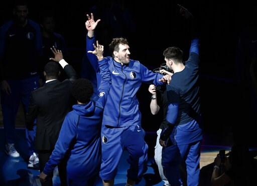 (AP Photo/Tony Gutierrez). Dallas Mavericks' Dirk Nowitzki (41) is introduced for the team's NBA basketball game against the Phoenix Suns in Dallas, Tuesday, April 9, 2019.