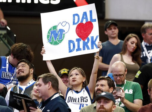 (AP Photo/Tony Gutierrez). A fan holds up a sign referring to Dallas Mavericks' Dirk Nowitzki during the first half of the team's NBA basketball game against the Phoenix Suns in Dallas, Tuesday, April 9, 2019.