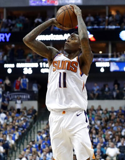 (AP Photo/Tony Gutierrez). Phoenix Suns guard Jamal Crawford shoots during the first half of the team's NBA basketball game against the Dallas Mavericks in Dallas, Tuesday, April 9, 2019.