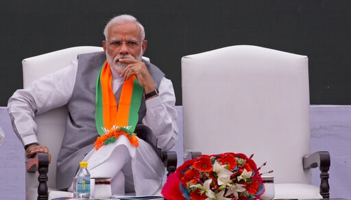 (AP Photo/Manish Swarup). In this Monday, April 8, 2019, photo, India's Prime Minister Narendra Modi releases Bharatiya Janata Party or BJP's manifesto for the upcoming general elections in New Delhi, India. Modi came to power in 2014 promising big-tic...