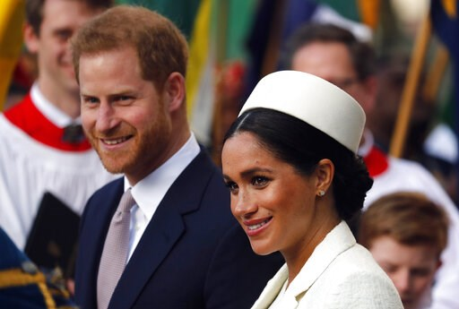 (AP Photo/Frank Augstein, file). FILE - In this Monday, March 11, 2019 file photo, Britain's Prince Harry and Meghan, the Duchess of Sussex leave after the Commonwealth Service at Westminster Abbey in London. Guinness World Records said Wednesday, Apri...