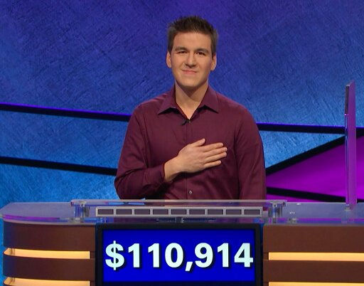 "(Jeopardy Productions, Inc. via AP). This image made from video aired on ""Jeopardy!"" on Tuesday, April 9. 2019, and provided by Jeopardy Productions, Inc. shows James Holzhauer.  The 34-year-old professional sports gambler from Las Vegas won more than ..."