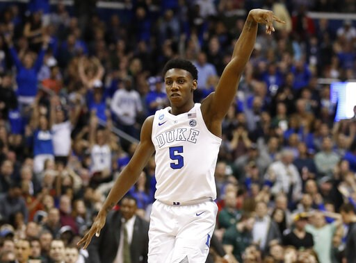 (AP Photo/Alex Brandon). Duke forward RJ Barrett (5) reacts after scoring against Michigan State during the second half of an NCAA men's East Regional final college basketball game in Washington, Sunday, March 31, 2019.