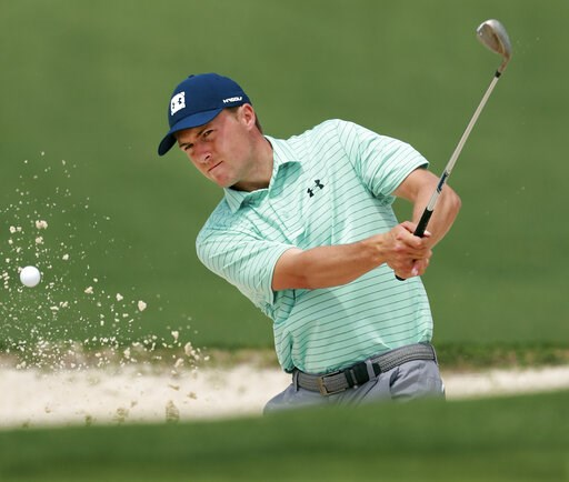 (Curtis Compton/Atlanta Journal-Constitution via AP). Jordan Spieth hits from the bunker to the second green during his practice round for the Masters at Augusta National Golf Club on Tuesday, April 9, 2019, in Augusta, Ga.