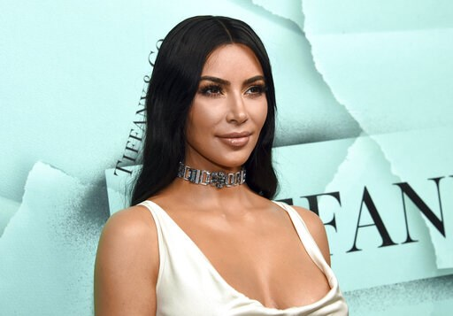 (Photo by Evan Agostini/Invision/AP, File). FILE - This Oct. 9, 2018 file photo shows Kim Kardashian West at the Tiffany & Co. 2018 Blue Book Collection: The Four Seasons of Tiffany celebration in New York. The reality star, makeup mogul and crimin...