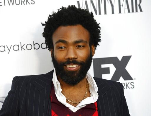 "(Photo by Chris Pizzello/Invision/AP, File). FILE - In this Sept. 16, 2018 file photo, Donald Glover, creator and star of the FX series ""Atlanta,"" and a musician who performs under the name Childish Gambino, poses at a private cocktail party to celebra..."