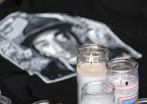 (AP Photo/Ringo H.W. Chiu). Candles appear at a makeshift memorial for rapper Nipsey Hussle in the parking lot of his Marathon Clothing store in Los Angeles, Monday, April 1, 2019. Hussle was killed in a shooting outside the store on Sunday.
