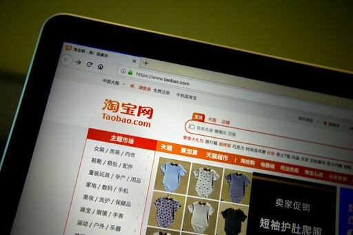 (AP Photo/Mark Schiefelbein). The home page of Chinese e-commerce site Taobao is seen on a computer screen in Beijing, Thursday, April 11, 2019. The mother of a Chinese child model has apologized after videos of her appearing to beat her daughter appea...