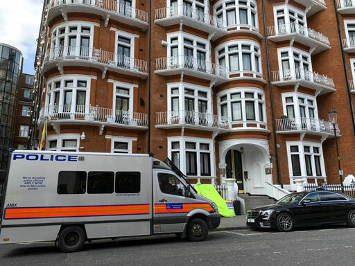 (Rebecca Brown/PA via AP). A police van parked outside the Ecuadorian Embassy in London, after WikiLeaks founder Julian Assange was arrested by officers from the Metropolitan Police and taken into custody Thursday April 11, 2019. London police say they...