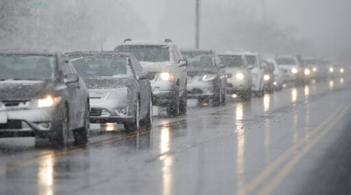 (AP Photo/David Zalubowski). Traffic backs up along 56th Avenue as a spring storm rolls in before the evening rush hour Wednesday, April 10, 2019, in Denver. Blizzard warnings have been issued for the northern half of Colorado's heavily populated Front...