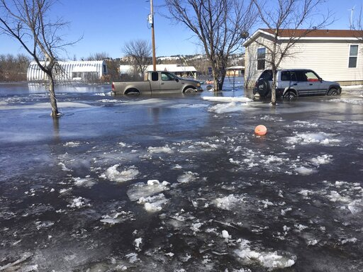 (Henry Red Cloud via AP). This March 2019 photo provided by Henry Red Cloud, shows flooding on Cloud's Lakota Solar Enterprises property on the Pine Ridge Reservation in southern South Dakota. Red Cloud estimates flood damage at $250,000. Plains and Mi...
