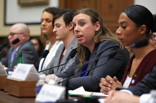 (AP Photo/Manuel Balce Ceneta, File). FILE- In this Feb. 27, 2019 file photo, Army Staff Sgt. Patricia King, second from right, together with other transgender military members, from left, Navy Lt. Cmdr. Blake Dremann, Army Capt. Alivia Stehlik, Army C...