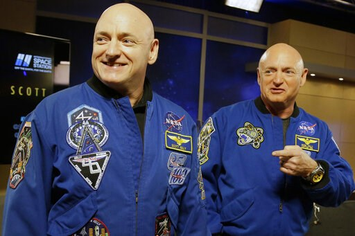 (AP Photo/Pat Sullivan, File). FILE - In this March 4, 2016 file photo, NASA astronaut Scott Kelly, left, and his identical twin, Mark, stand together before a news conference in Houston. From his eyes to his immune system, Scott's body sometimes react...