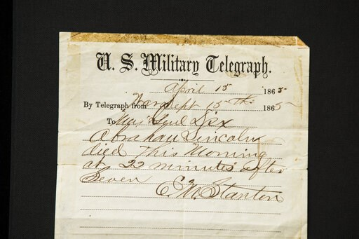 (AP Photo/Matt Rourke). This photo shows a handwritten notification of President Abraham Lincoln's death that is being offered for sale by Raab Collection in Ardmore, Pa., Thursday, April 11, 2019. The telegram was written inside a home where Lincoln w...