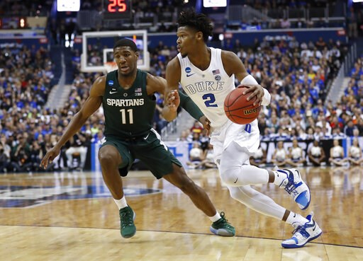 (AP Photo/Patrick Semansky). Duke forward Cam Reddish (2) drives around Michigan State forward Aaron Henry (11) during the first half of an NCAA men's East Regional final college basketball game in Washington, Sunday, March 31, 2019.